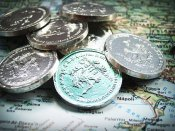 coins over map