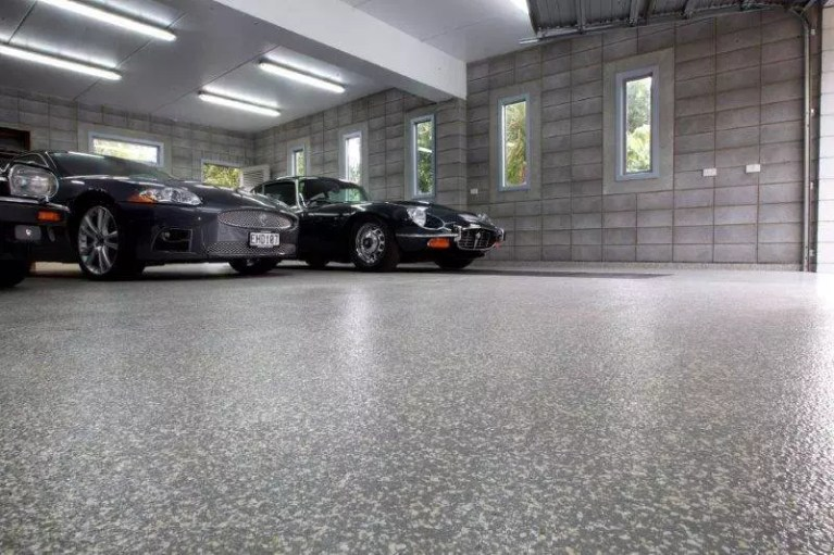 Garage floor coated with polyaspartic flake coating.