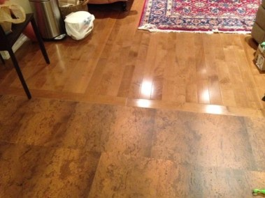 Hardwood with transition by Floors Direct North