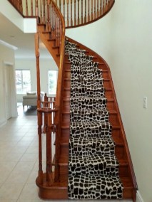 A custom staircase with fancy runner by Floors Direct North