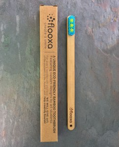 Bamboo toothbrush front view and packaging