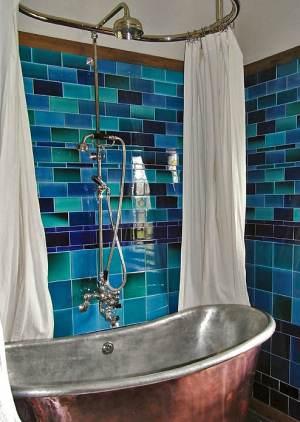 Blue tiles on a bathroom wall