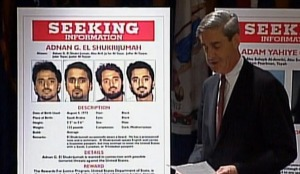 FBI Director Robert Mueller  with wanted poster for Adnan Shukrijumah