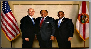 Clarence McKee, center, with  Gov. Rick Scott and former U.S. Rep. Allen West. Photo: McKee Communications