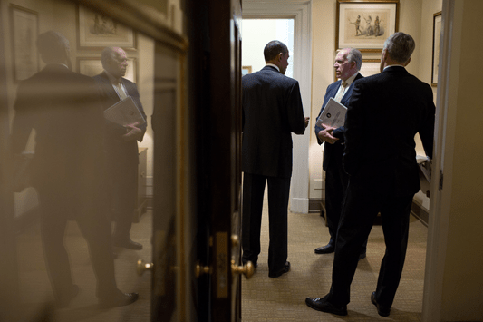 President Barack Obama talks with CIA Director John Brennan, center, and Chief of Staff Denis McDonough in a West Wing hallway of the White House, May 10, 2013. (Official White House Photo by Pete Souza)