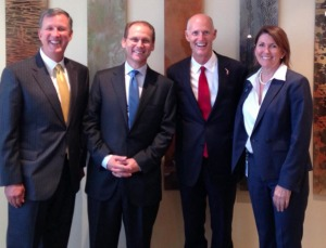 The Foley & Lardner law firm recently removed from its Facebook page this photo of Gov. Scott paying a visit to its Jacksonville office on Aug. 24. Pictured with the governor, left to right, are Scott's former environmental secretary Herschel Vinyard, office managing partner Kevin Hyde and Karen Bowling, Scott's ex-partner in the Solantic urgent-care clinic chain