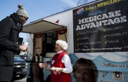 Carol Berman, of West Palm Beach speaks with pedestrians about the need for policymakers to protect Medicare Advantage benefits during the Coalition for Medicare Choices' Medicare Advantage Food Truck stop on North Capitol Street in Washington on Monday, March 9, 2015. Photo: Bill Clark/CQ Roll Call