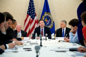 FBI Director James Comey discusses the 9/11 Review Commission's findings during a press conference at FBI headquarters on March 25, 2015. Former Attorney General Edwin Meese (left), and former Congressman Tim Roemer (right), are also pictured.