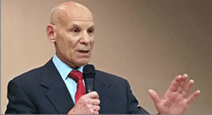 Photo of Broward State Attorney Michael J. Satz speaking before an audience