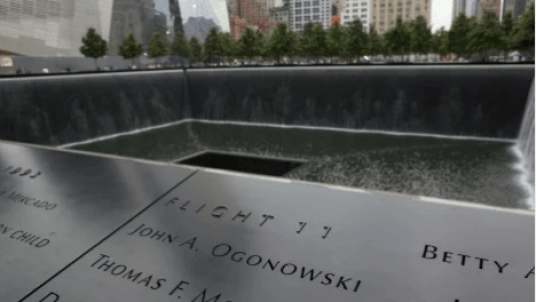 A large black waterfalls and pool set within the footprint of one of the Twin Towers that were destroyed on 9/11.