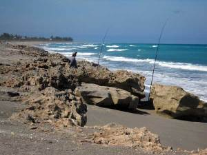 Fishermen at Blowing Rocks, Jupiter, Florida, beach