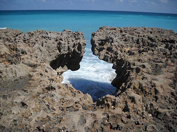 A hole in the rocks at Blowing Rocks, Jupiter, Florida, beach