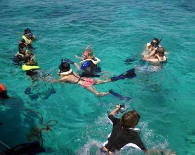 Snorkelers begin exploring the Mandalay wreck at Biscayne National Park