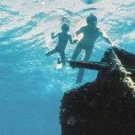 Family snorkels the Mandalay shipwreck