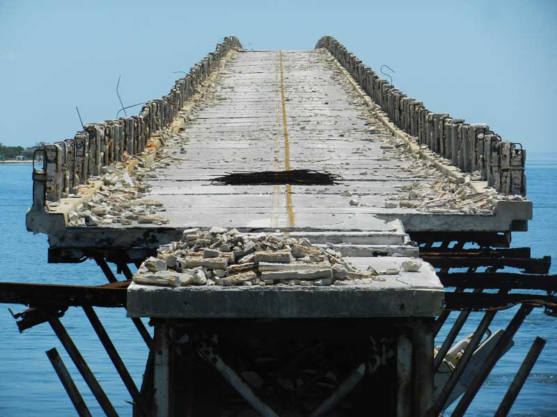 Medium image of view of old and crumbling bahia honda bridge from the southern end