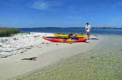 Clear water and a pristine beach await you on a kayak trip to Atsena Otie Key.