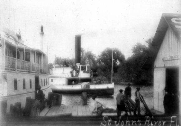 """The steamboat """"Louise"""" ties up at Blue Spring Landing."""
