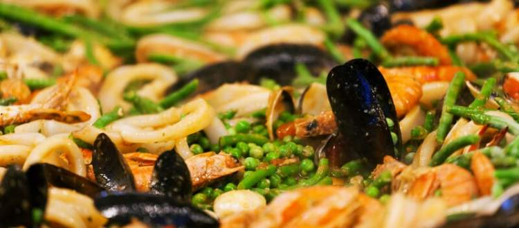 Paella is a popular seafood dish in Florida