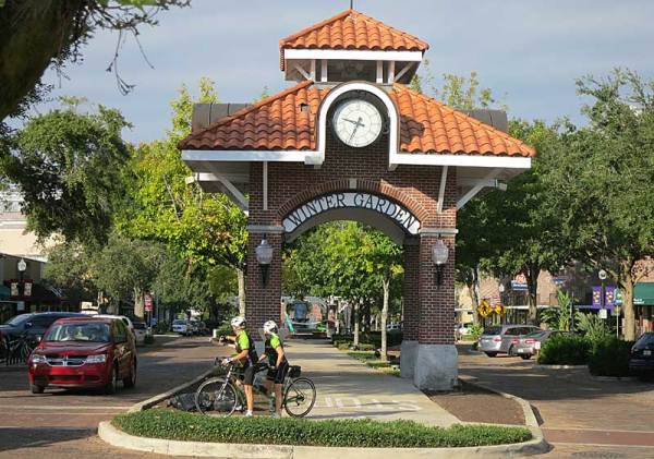 Bicyclists in downtown Winter Garden, pedaling the West Orange Trail.