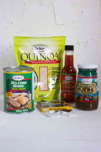 An assortment of Grace Food products including Quinoa, Bouillion Cubes, Jerk Marinade, Hot Sauce