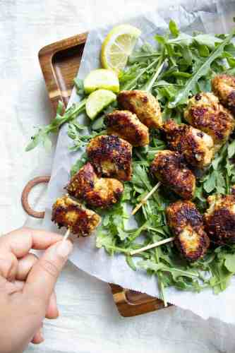 Sesame Ginger Chicken Skewers, one being picked up