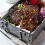 Instant Pot Shami Kababs in a rectangular tray with a dipping sauce and tea in the background