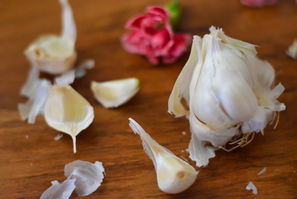 close-up-of-garlic-bulb-and-cloves-and-florals