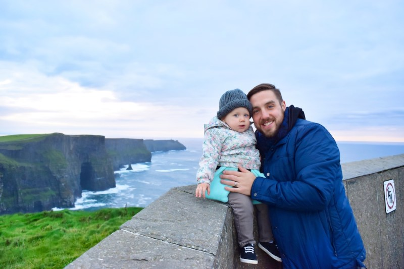 Lil babe Clara and a young Tommy at the Cliffs of Moher on an Irish cloudy day.