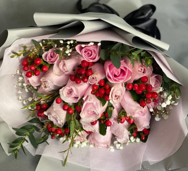 pink roses with red hypericum