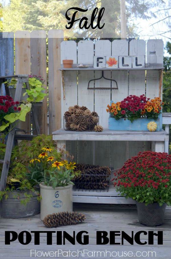 DIY Potting Bench deck out for Fall! Easy to build and so fun to decorate. Mums, pine cones and more create fun Farmhouse or Cottage diy decor.  #falldecor #pottingbench #diyfarmhouse #diydecor #fallcrafts #autumn #cottagestyle