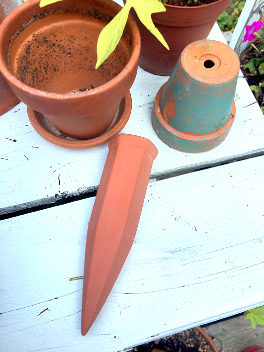Terra Cotta Plant Waterer and Painted Bottles, use empty wine bottles and these wonderful terra cotta plant nannies to effortlessly but beautifully keep your plants watered.  They distribute only what your plants need and will keep them hydrated even when you are away.  Using enamel paints keeps the design fresh and vibrant!