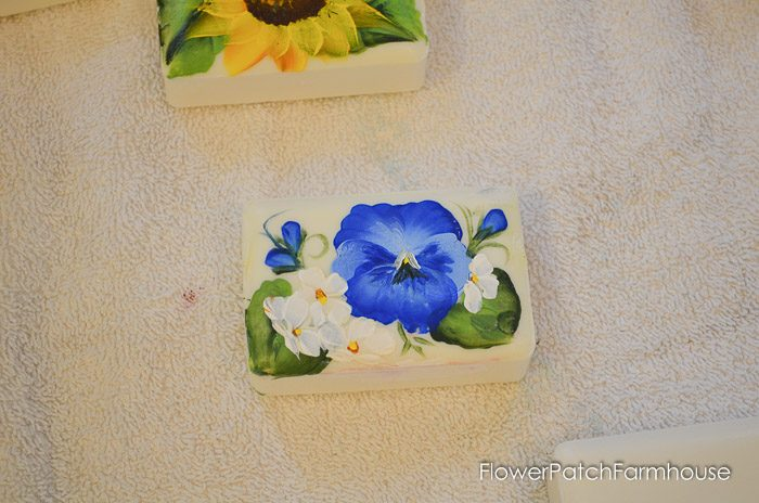 Paint a Blue Pansy on a Bar of Soap. How to Paint Flowers on Bars of Soap. Great DIY gifts, decor and just plain fun! Create beautiful miniature paintings on soap with craft paints.