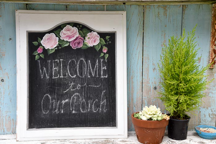 Cabinet door painted as a framed chalkboard with pink roses, DIY frames from cabinet doors.