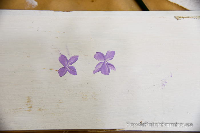 middle bottom petal painted on a dog violet