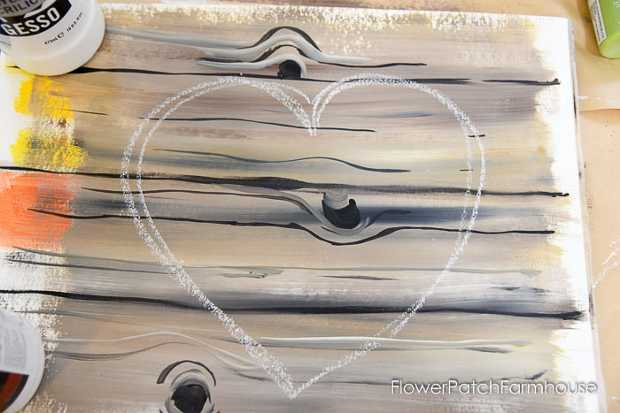 heart drawn with chalk on faux painted wood