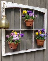 Unique garden decor with pansies flowers in pots hanging ...