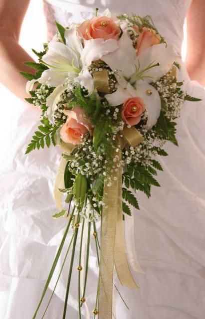 Large wedding bouquet with white lily and peach color
