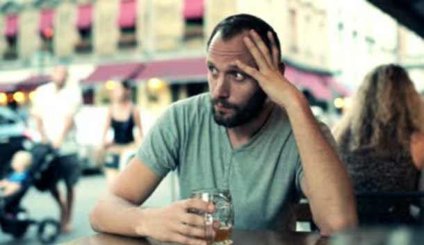 Depressed-man-sitting-in-city-cafe2