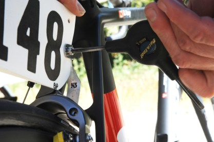 Putting race numbers on our K3 holders before the start of the San Dimas ©VeloImagesStage Race
