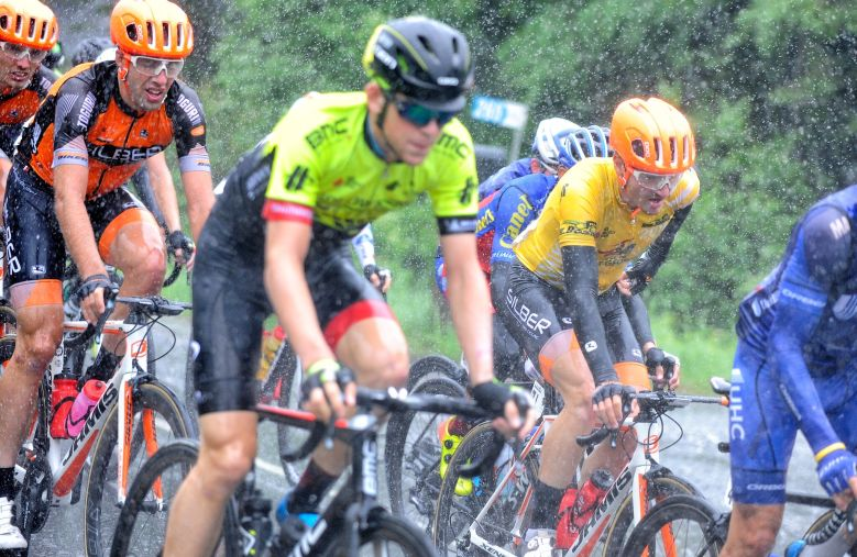 Côté (in yellow) and Jean battle the rain. pic: VeloImages