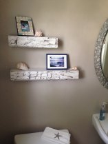 Hand-hewn rustic white floating shelf installed by Etsy client