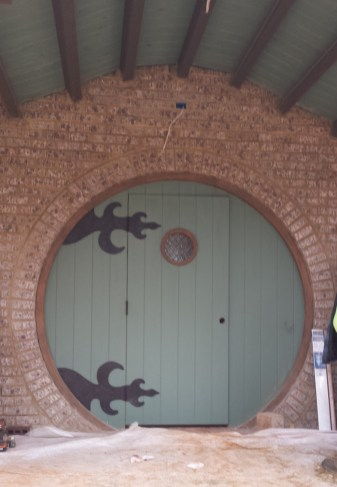 Hand-forged custom hinges for a custom hobbit door
