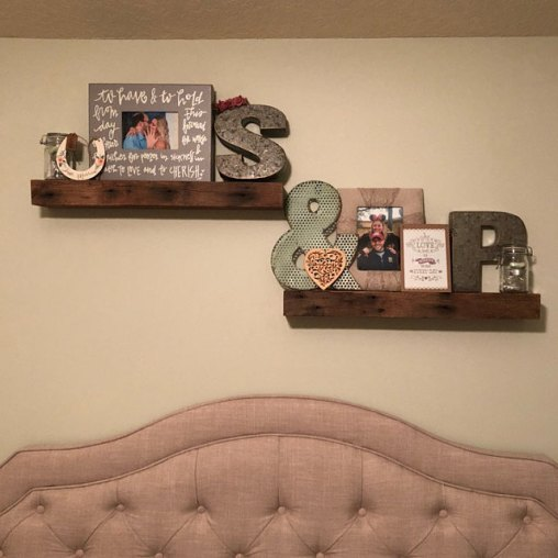 Rustic floating shelves with dark iron stains installed by an Etsy customer