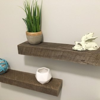 Rustic gray-brown floating shelves installed by an Etsy customer