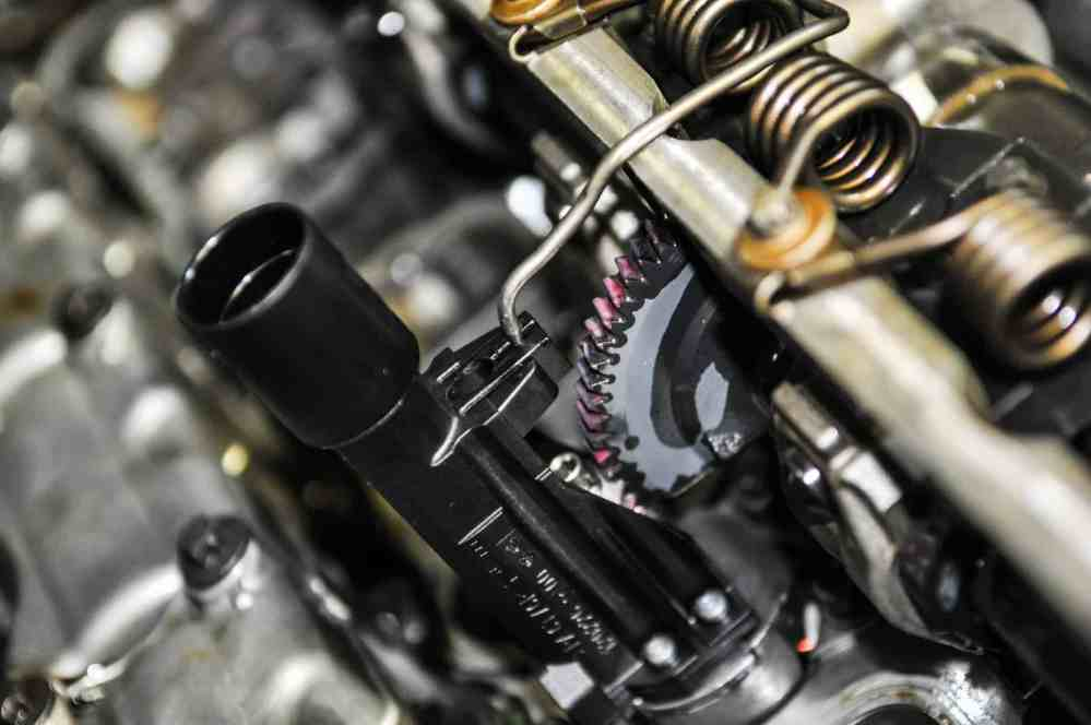 medium resolution of removing it requires the removal of the valve cover special bmw tooling is required to release tension from the shaft springs and levers