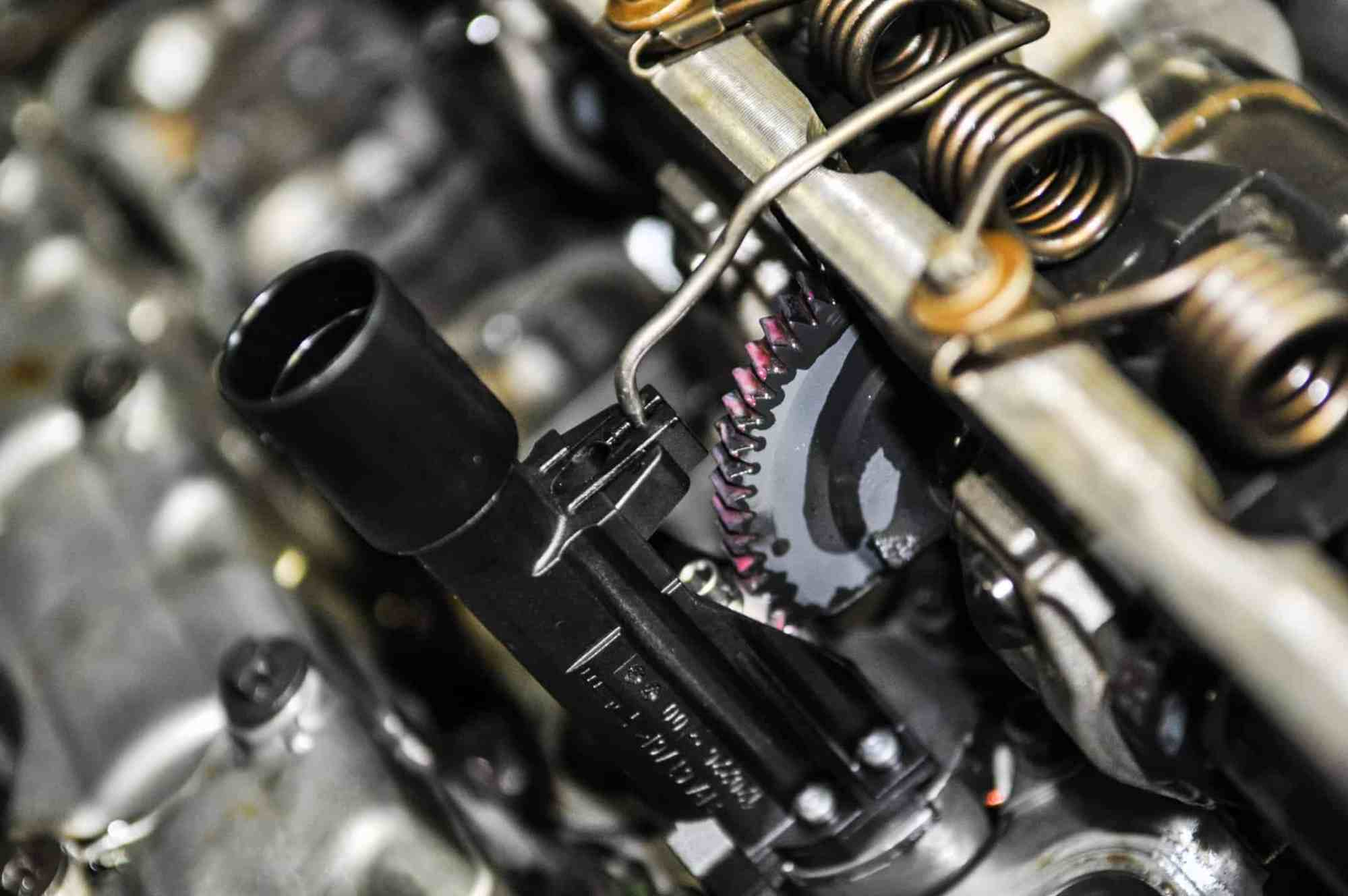 hight resolution of removing it requires the removal of the valve cover special bmw tooling is required to release tension from the shaft springs and levers