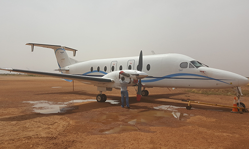 In The Sands Of Niamey After A Flight Putting On The Aircraft Covers