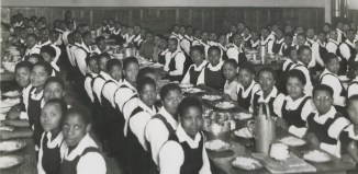 """""""Meal Time in the Girls' Hostel,"""" South Africa (Image source: http://murraymcgregor.wordpress.com/chapter-15-the-chaos-of-%E2%80%9Cbantu%E2%80%9D-education/)"""
