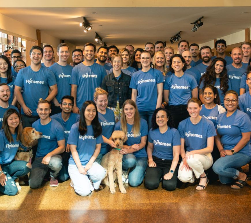 Flyhomes team members and dogs