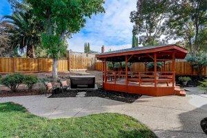 backyard with gazebo and hot tub